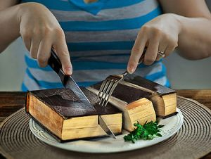 Book Sliced Up on Plate with Knife